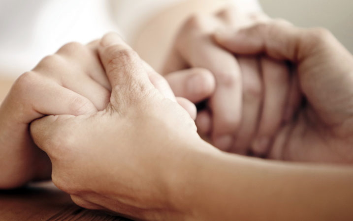 Hands-clasped-forgiveness