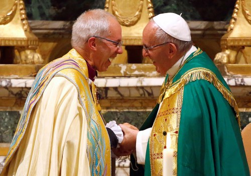 Pope Francis (R) smiles with Archbishop of Canterbury Justin Welby at the end of vespers prayers at the monastery church of San Gregorio al Celio in Rome, Italy, October 5